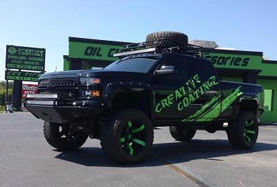 Business logo on lifted truck with custom wheels